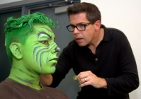A member of Many but ONE gets some Grinchy makeup.