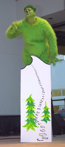 Grinchy glares from his mountain.
