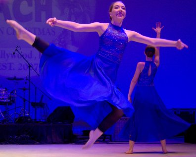 Blue-gowned dancers dance to a soulful version of Joy to the World.