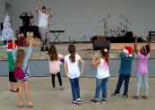 Sean Olivera leads kids in some hip-hop, a role he'll fill two or three times over the night.