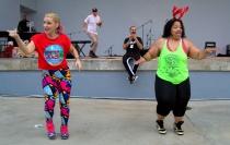 Deena and a friend help Sean lead dancing.