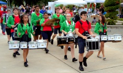 The drumline of Chaminade-Madonna High School gets everyone's attention . . .