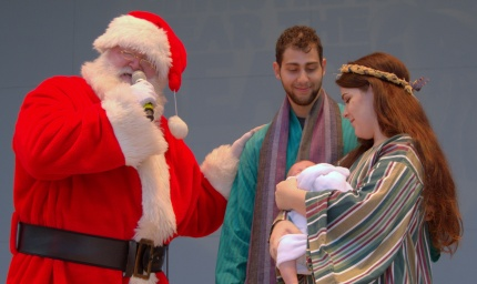 Then he sings a carol honoring the Christ Child.