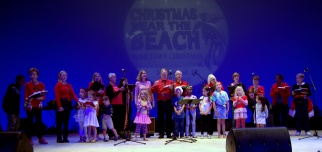 The choir of First Presbyterian Church invites children from the audience to help sing Silent Night.