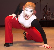 Deena performs a narrated mime in three roles, as a satanic accuser . . .